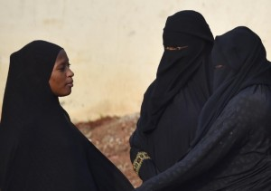 Full-face veils including the niqab, worn by the two women at right in this July 23, 2015 photo from Abidjan, capital of the Ivory Coast, would be barred from wearing such veils in member states of ECOWAS if proposed new bans are enacted (AFP Photo/Issouf Sanogo)