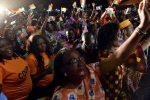 Supporters of Burkina Faso's new president Roch Marc Christian Kabore celebrate at party headquarters in Ouagadougou on December 1, 2015 after he won Burkina Faso's presidential election (AFP Photo/Issouf Sanogo)