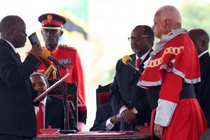 Tanzania's President-elect John Magufuli takes the oath of office during his inauguration ceremony at the Uhuru Stadium in Dar es Salaam on November 5, 2015. Magufuli has ordered that newly appointed government officials sign an integrity pledge in public as part of his bid to root out corruption from the government in Dar es Salaam. EMMANUEL HERMAN/REUTERS