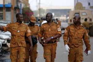 Burkinabe soldiers walk outside the Splendid Hotel in Ouagadougou, Burkina Faso, January 17, 2016,. REUTERS/Joe Penney