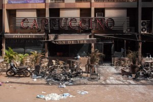 Debris outside the Cappuccino cafe Monday, Jan. 18, 2016, after militants led an attack on a hotel and a cafe popular with foreigners over the weekend in Ouagadougou, Burkina Faso. In the wake of the attack that left over 30 dead, security was beefed up across Burkina Faso's capital Monday as businesses and banks reopened. The West African nation also announced a joint effort with Mali in the fight against jihadi elements in the West African region. (AP Photo/Theo Renaut)