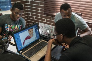 Nigerian illustrators are seen working on various projects at the Comic Republic office in Lagos (AFP Photo/Stefan Heunis)