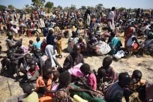 FILE - Some of more than 30,000 people who flocked into Leer town, South Sudan, to receive food from the International Committee of the Red Cross, Dec. 15, 2015, which marked the two-year anniversary of South Sudan's civil war.