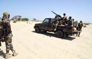 Niger soldiers ride in a military vehicle on May 25, 2015 in Malam Fatori, in northern Nigeria, near the border with Niger, where the Niger and Chadian army troops are working together to counter Boko Haram (AFP Photo/Issouf Sanogo)