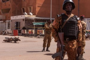 Burkina Faso troops provide security in the area Monday, Jan. 18, 2016, after militants led an attack on a hotel and a cafe popular with foreigners over the weekend in Ouagadougou, Burkina Faso. In the wake of the attack that left over 30 dead, security was beefed up across Burkina Faso's capital Monday as businesses and banks reopened. The West African nation also announced a joint effort with Mali in the fight against jihadi elements in the West African region. (AP Photo/Theo Renaut)