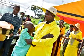 President Museveni with an elderly woman after addressing a rally at Kiyunga Town Council, Luuka