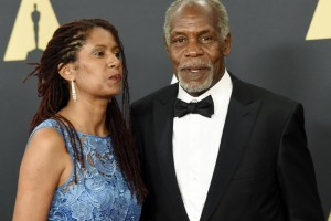 Danny Glover and Eliane Cavalleiro, left, at the Academy of Motion Picture Arts and Sciences Governors Awards in Los Angeles, California, November 8, 2014. Glover stars in the controversial Nigerian film '93 Days', about the country's first Ebola case. KEVORK DJANSEZIAN/REUTERS