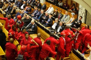 Members of the Economic Freedom Fighters political party leave the inside of parliament during President Jacob Zuma's State of the Nation address in Cape Town on February 11, 2016 (AFP Photo/Schalk van Zuydam)