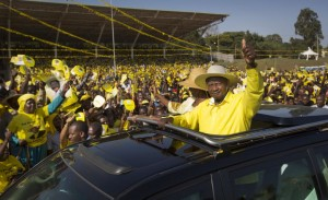 FILE - In this Tuesday, Feb. 16, 2016 file photo, Uganda's long-time President Yoweri Museveni waves to supporters from the sunroof of his vehicle as he arrives for an election rally at Kololo Airstrip in Kampala, Uganda. Uganda election commission declared on Saturday, Feb. 20, 2016 President Yoweri Museveni the winner of elections, with more than 60 percent of vote. (AP Photo/Ben Curtis, File)