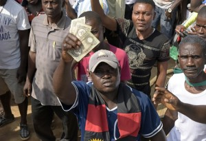 A pro-Biafra supporter holds outlawed Biafran banknotes during a protest calling for Nnamdi Kanu's release, in November 2015AFP/Getty