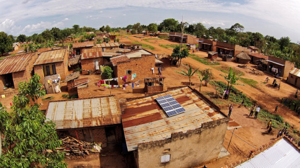 A 500 watt solar system in a rural village in Uganda powers a home, drives a public broadcasting system, a barbershop and a video hall and generates new income for the business owner. Photo by: Sameer Halai / SunFunder / USAID