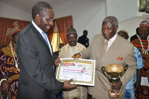 Dr. Fomunyoh is presented with the award by Batonnier Emeritus of the Cameroon Bar Association and former chairman of the AFP opposition party , Barrister Ben Muna