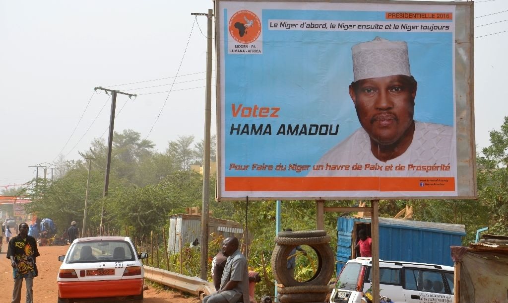 A campaign poster depicting Niger's leading opposition figure and contender Hama Amadou, jailed since November 2015 over his alleged involvement in a baby-trafficking scandal, on February 2, 2016 A campaign poster depicting Niger's leading opposition figure and contender Hama Amadou, jailed since November 2015 over his alleged involvement in a baby-trafficking scandal, on February 2, 2016 (AFP Photo/Boureima Hama)