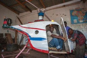 Felix Kambwiri sits in the cockpit of the helicopter he built during the last four months out of scrap metal and fibreglass in his garage in the village of Gobede, Malawi (AFP Photo/Amos Gumulira)