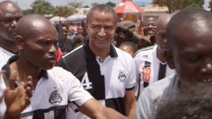Mr Katumbi, centre, is surrounded by fans of his football club, who are the reigning African football champions