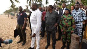 President Ouattara (centre) visited the beach resort after the attack