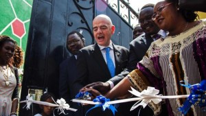 Fifa president Gianni Infantino cuts the ribbon to open the South Sudan FA's office