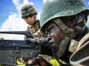 A Senegalese service_member fires a weapons during a live fire exercise as part of Africa Partnership Station (APS) 2013 in Thies, Senegal