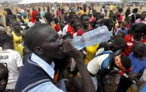 A refugee from South Sudan drinks water at a well during celebrations to mark World Refugee Day at the Kakuma refugee camp in Turkana District, northwest of Kenya's capital Nairobi, June 20, 2015. REUTERS/Thomas Mukoya