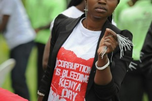 A young woman campaigns against alleged government corruption in Nairobi, Kenya, December 9, 2015. Kenya has been beset by various corruption scandals under President Uhuru Kenyatta. TONY KARUMBA/AFP/GETTY IMAGES