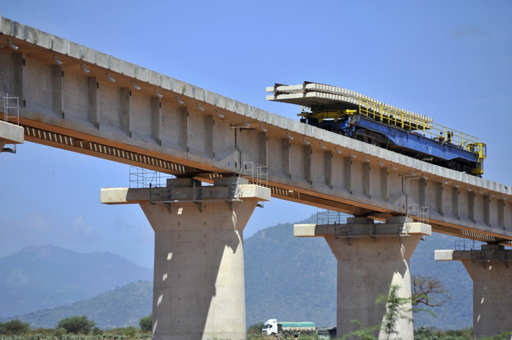 A wagon carries railway sleepers on a superbridge which will form part of the railway Photographer: Riccardo Gangale/Bloomberg