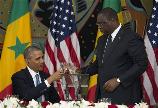 U.S. President Barack Obama, left, and Senegalese President Macky Sall toast during an official dinner at the Presidential Palace on Thursday, June 27, 2013, in Dakar,