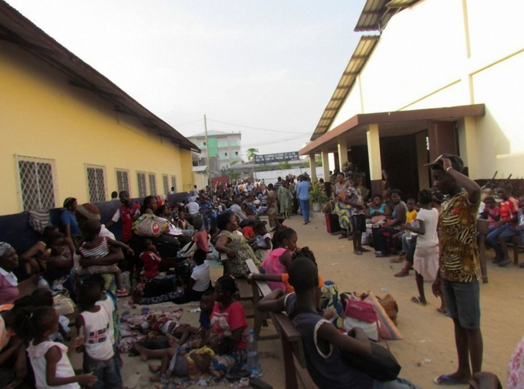 Congolese displaced residents from the southern districts of Brazzaville take shelter in a church after fleeing intense clashes between security forces and unknown assailants on April 4. (AFP/Getty Images)