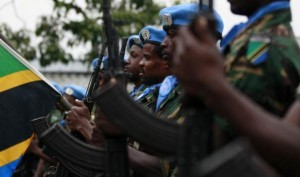 This Aug 31, 2013 file photo shows U.N. peacekeepers from Tanzania attending a special parade for a slain colleague outside Goma in the eastern Democratic Republic of Congo. REUTERS/Thomas Mukoya