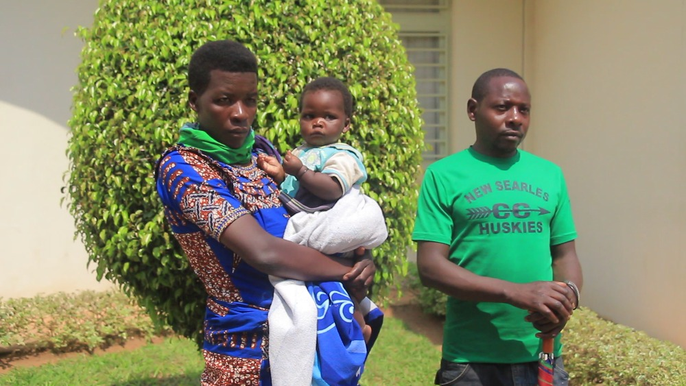 Muhawenimana (right) with his wife Dusabimana and the baby who was born in prison