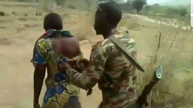A snapshot of the video where one of the soldiers accompanied a victim to the execution site
