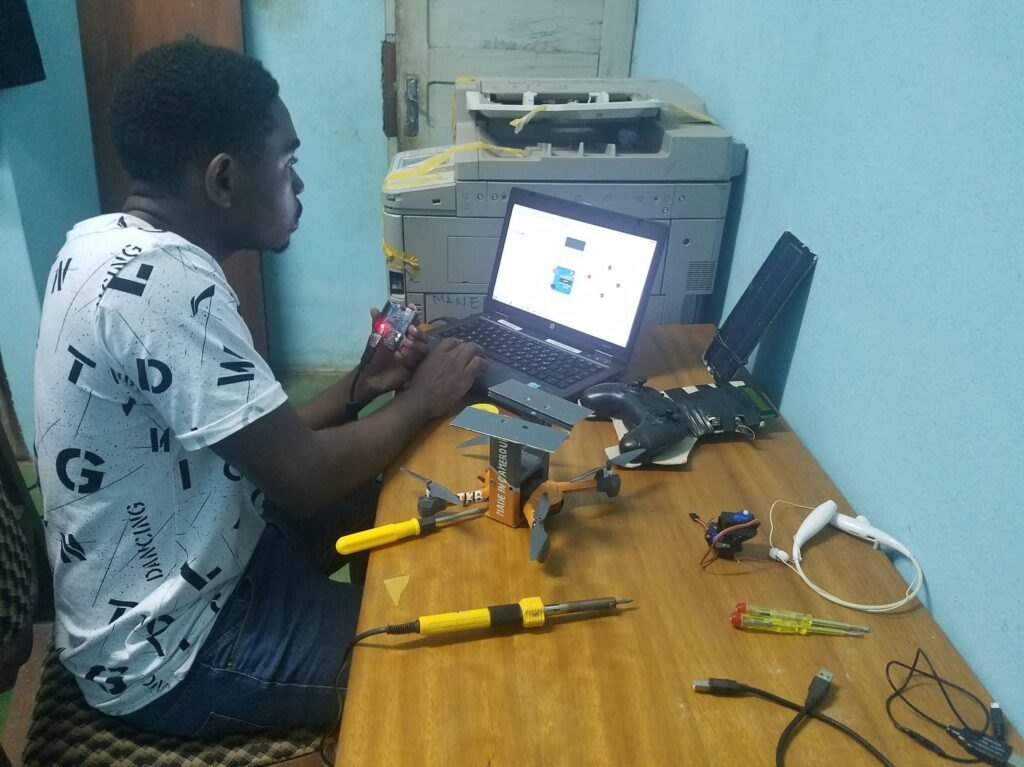 Borel Teguia working on his protype drone