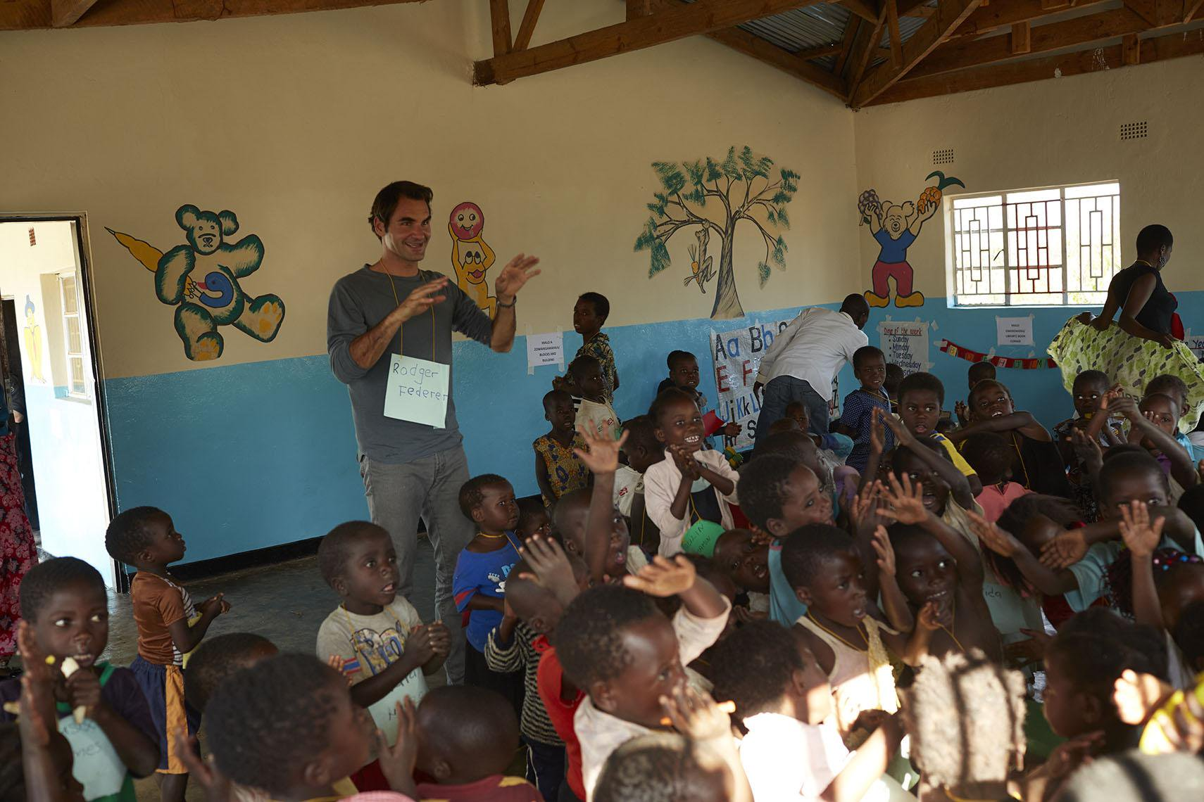 File Picture.Federer in a previous visit to Malawi.His School Readiness Programme is expected to help thousands of early childhood going children up to 2025