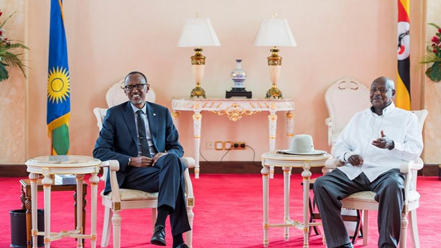 President Kagame (left) chatting with President Museveni