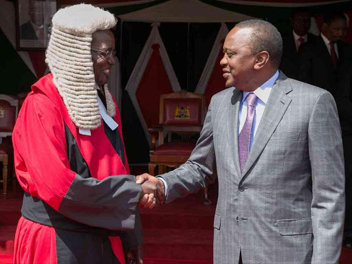File Picture.President Uhuru Kenyatta congratulates the newly-sworn-in Chief Justice David Maraga at State House. /PSCU