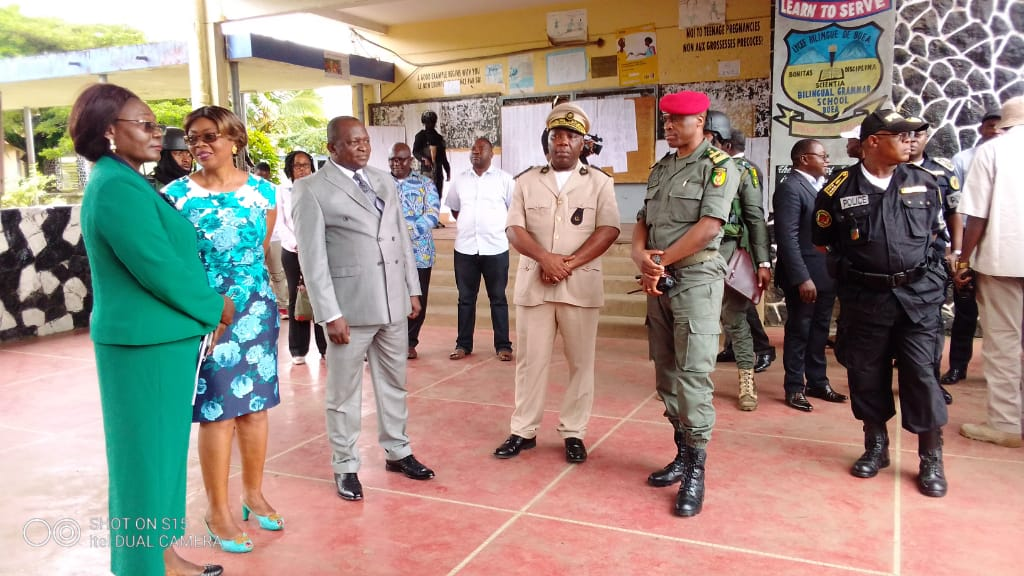 Governor of the SWR together with adminstrators inspecting schools in Buea