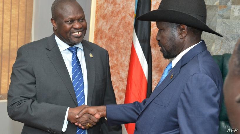 South Sudan's President Salva Kiir (R) shakes hands with opposition leader Riek Machar before their meeting in Juba, South Sudan, Sept. 11, 2019.