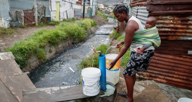 File Picture.A resident of the Masiphumelele informal settlement collects drinking water from a communal municipal tap in Cape Town, South Africa. Photograph: Nic Bothma/EPA