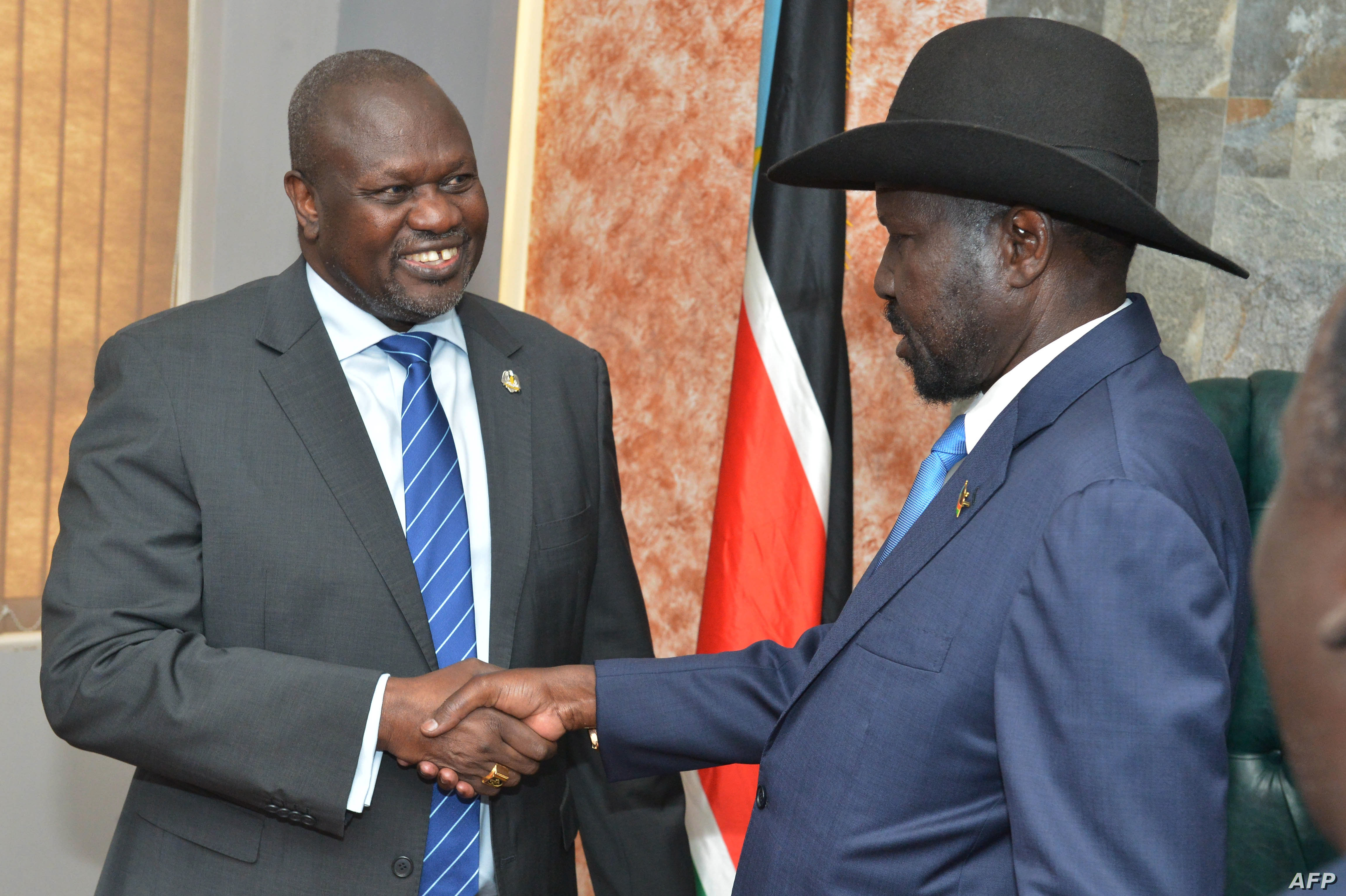 South Sudan's President Salva Kiir (R) shakes hands with opposition leader Riek Machar before their meeting in Juba, South Sudan, Sept. 11, 2019. Photo credit VOA