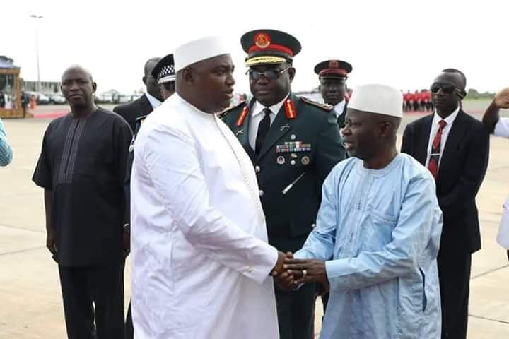 Adama Barrow shakes hands with Ousainou Darboe who was sacked as his deputy. Photo: Facebook/ Omar Wally