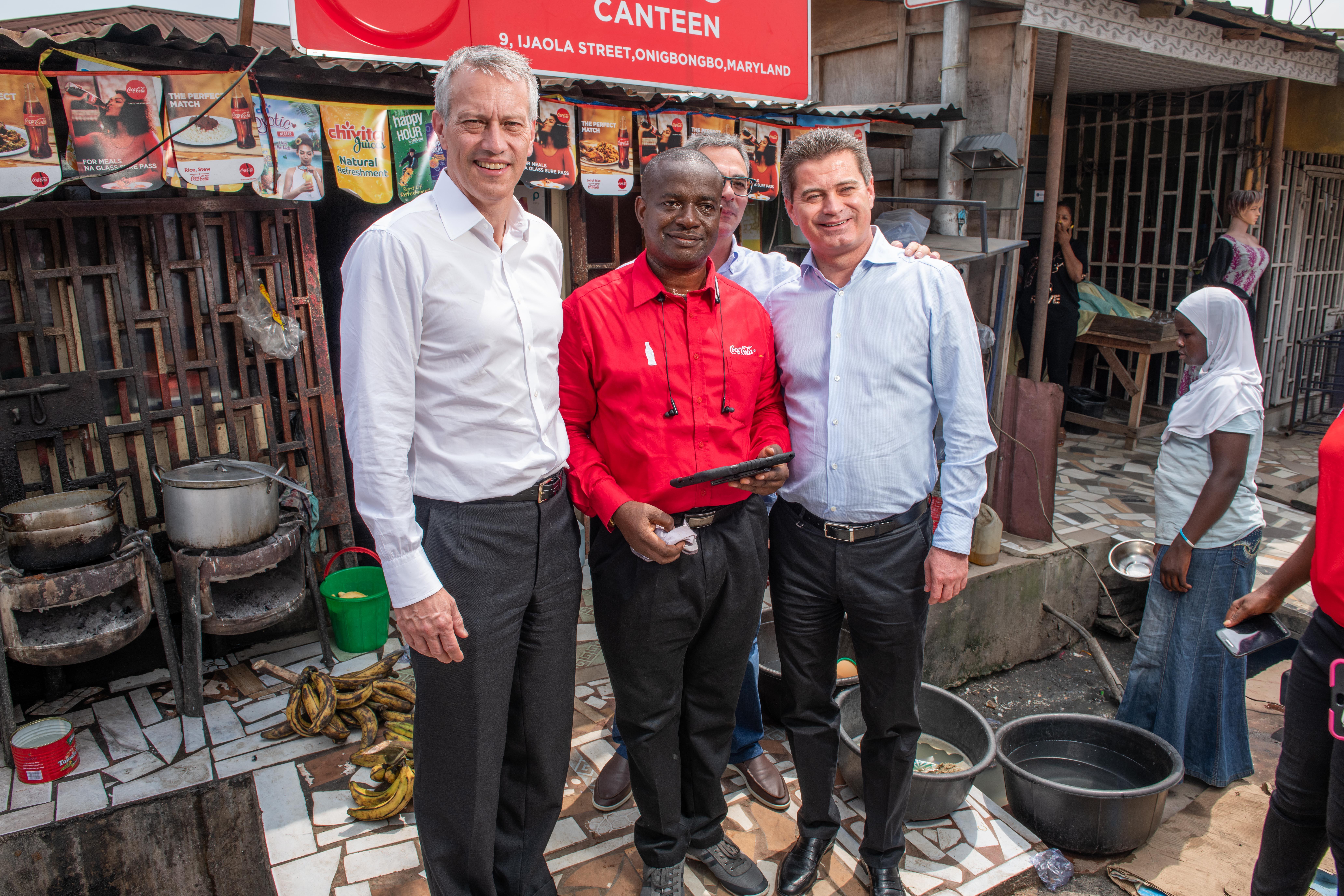 James Quincey, Chairman & CEO The Coca-Cola Company, a Nigeria Bottling Company Sales Representative and Zoran Bogdanovic, Coca-Cola Hellenic CEO during a market visit at Maryland in Lagos