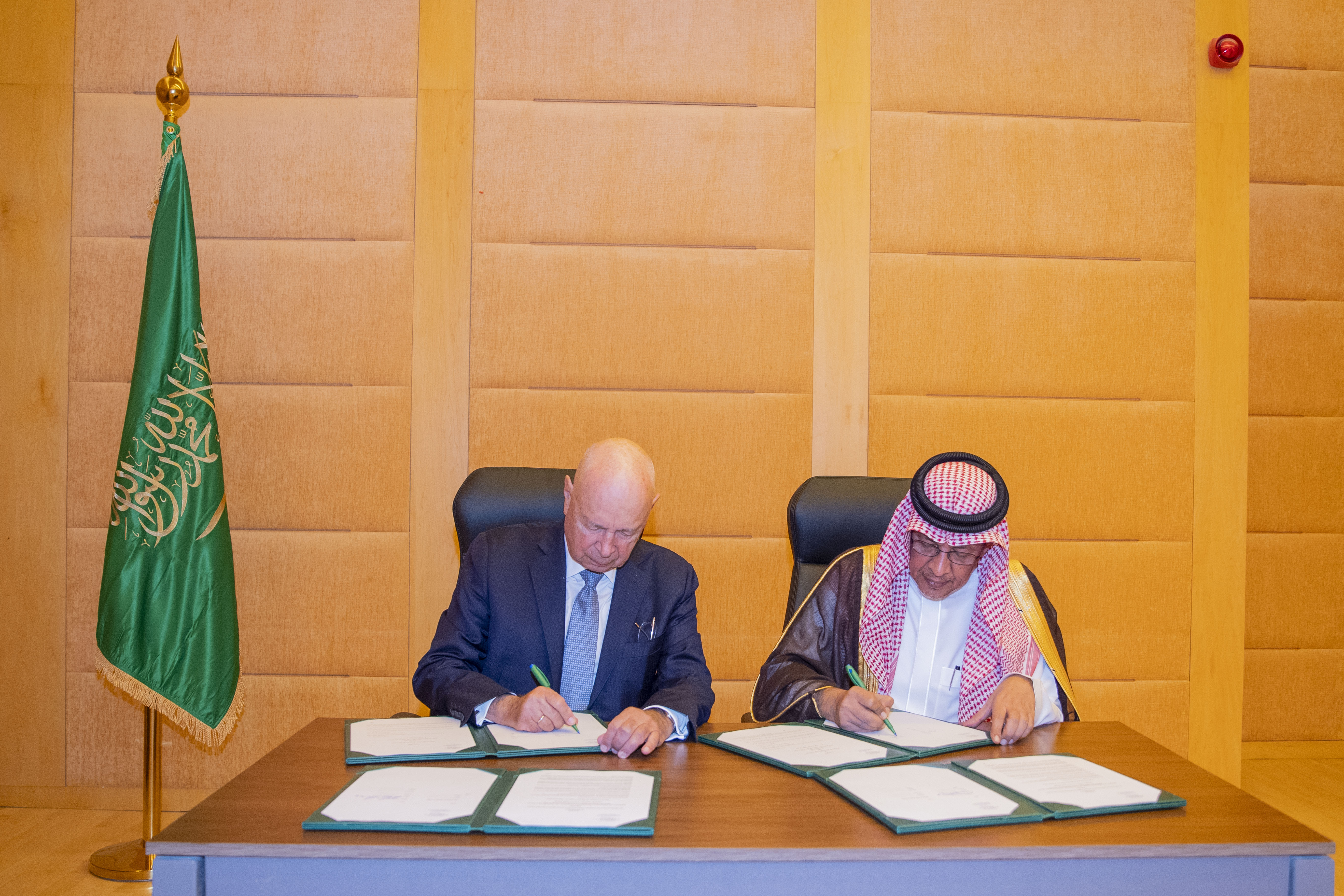 H.E. Mohammed Al-Tuwaijri, Minister of Economy and Planning, and Professor Klaus Schwab, Founder and Executive Chairman of WEF sign agreement in Riyadh Nov 6, 2019