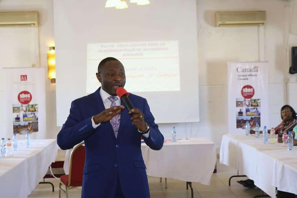Tatoh Kenneth Ndi, a seasoned Finance Manager speaking to entrepreneurs at the SBEC training in Douala