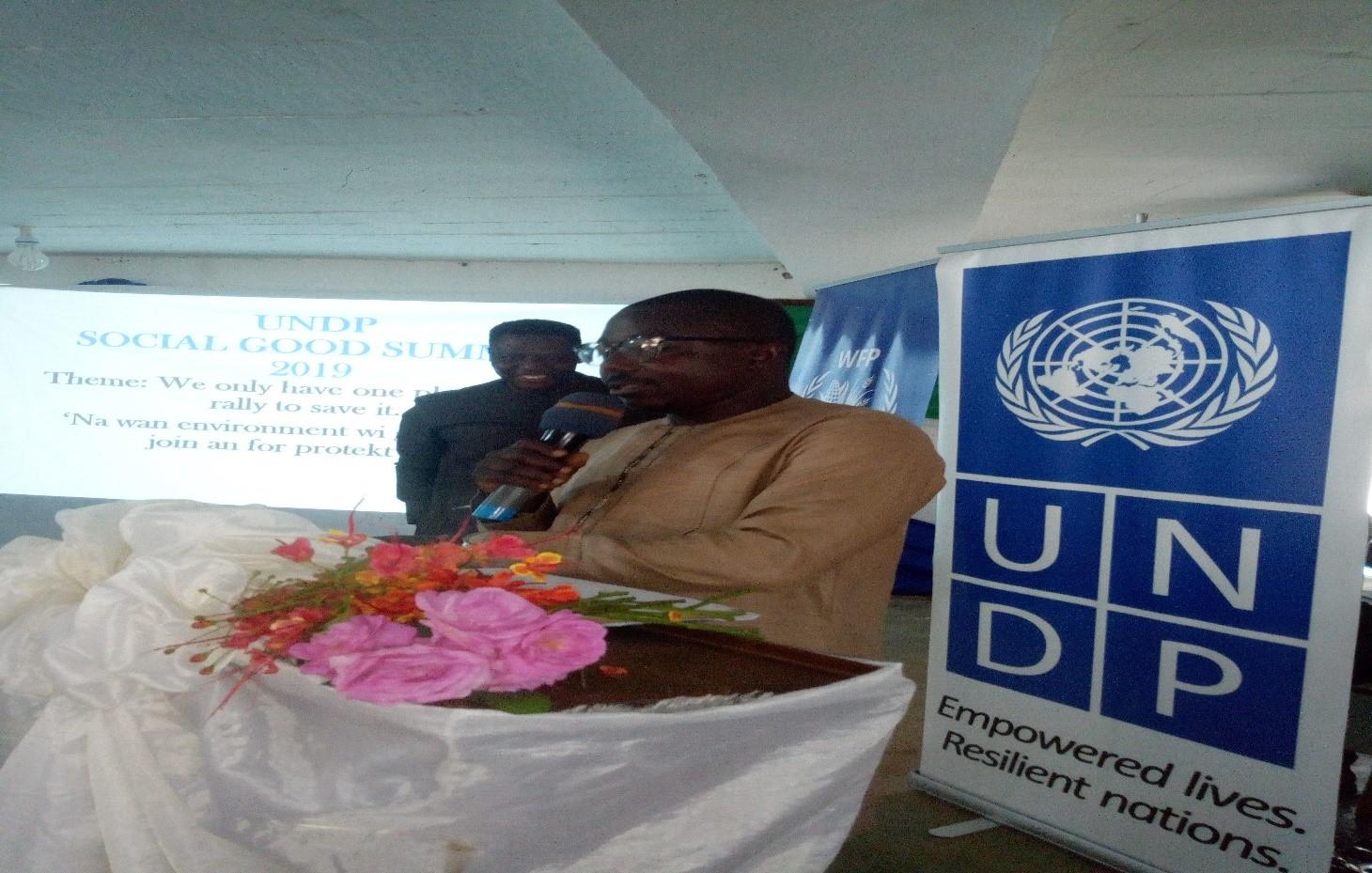 Registrar John Juana speaking at the social Good Summit in Kenema