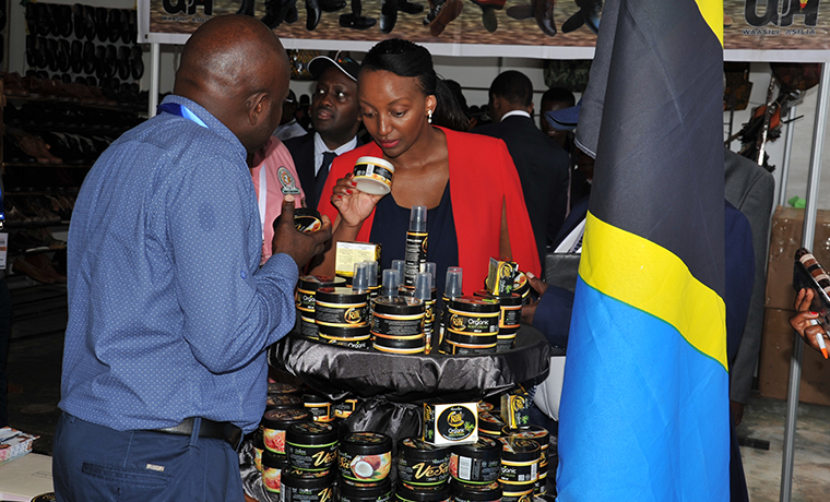 Rwanda's Minister of Trade , Ms Soraya Hakuziyaremye looking at the products that are being exhibited in East African Community Micro, Small and Medium Enterprise Trade Fair
