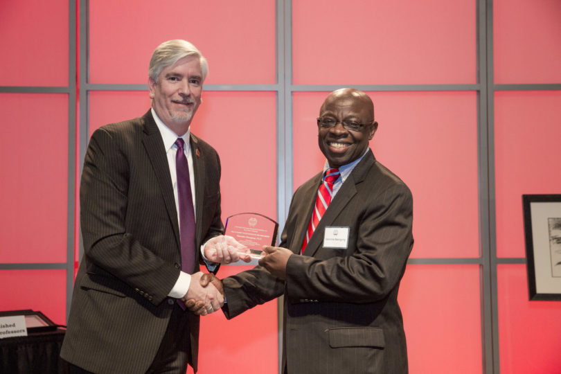 Valentine Nzengung, right, receives the Academic Entrepreneur of the Year Award in 2016 from Derek Eberhart, associate vice president for research. (UGA file photo)