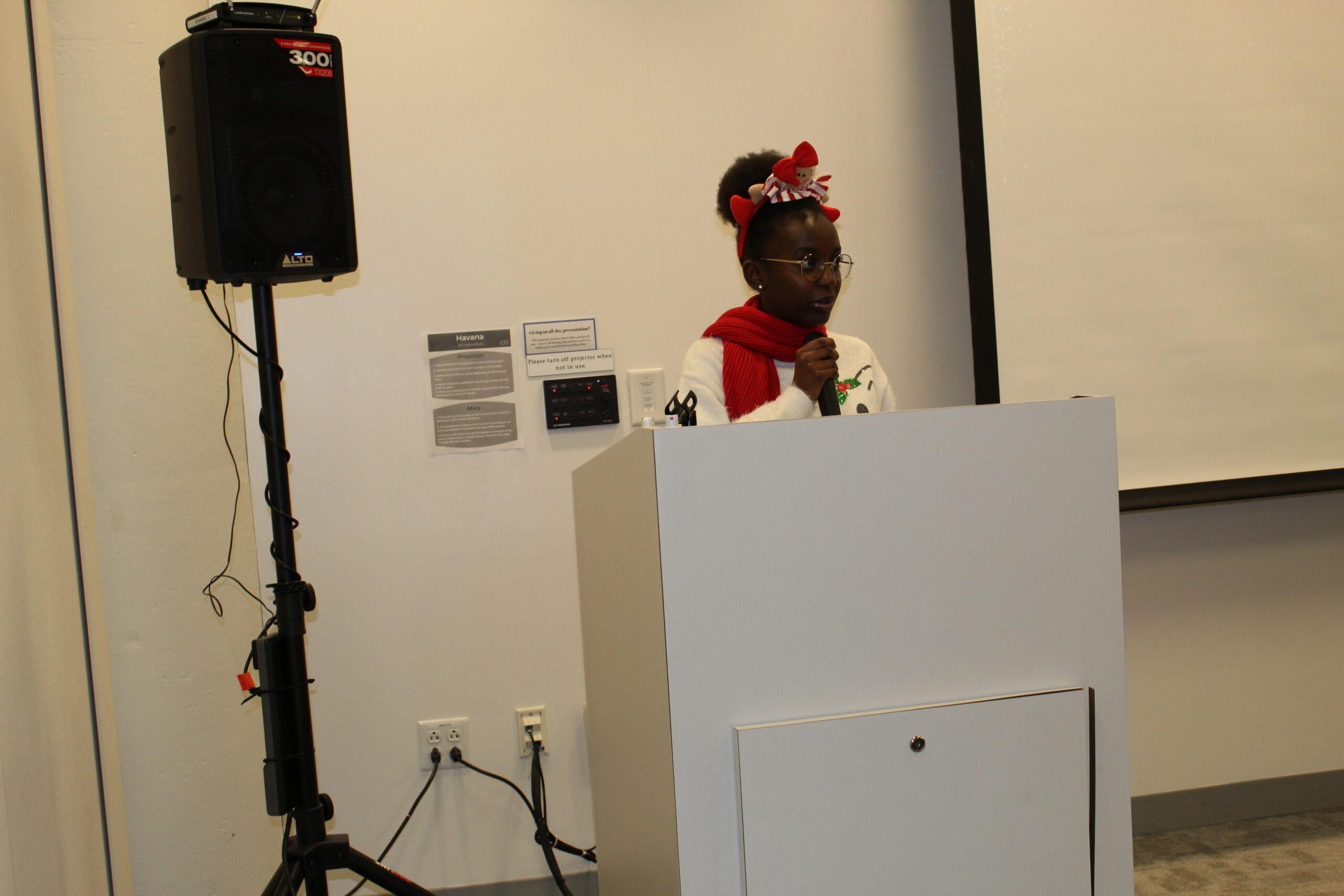 Miss.Bridget Mwaniki speaking to the immigrants at Cortex building in Saint Louis City, U.S