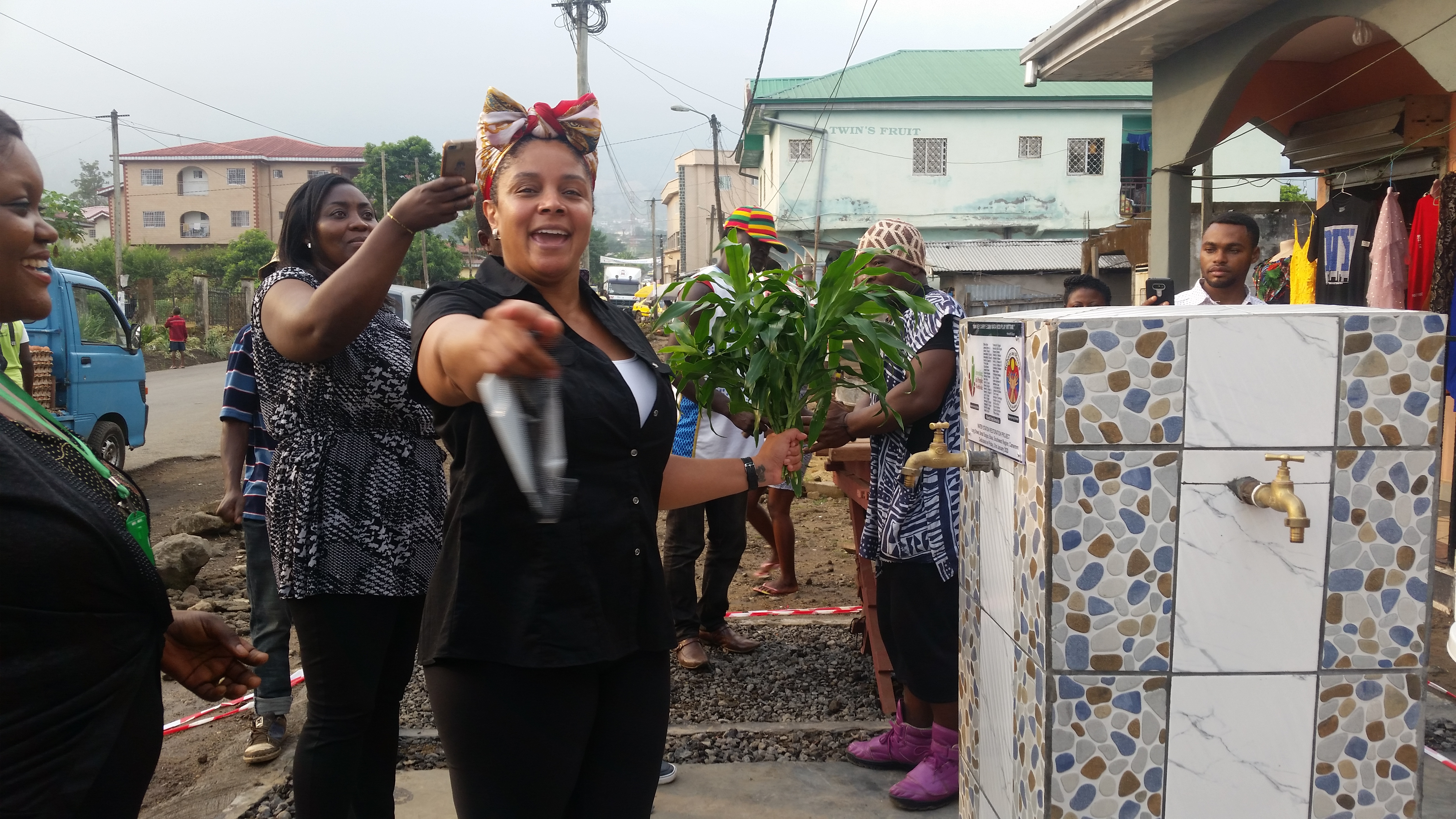 Mrs Renėe Duguė from Reborn and Rising (USA) Commissions the Water Station Restoration Project as Ruth Bisong, IPW Director looks on