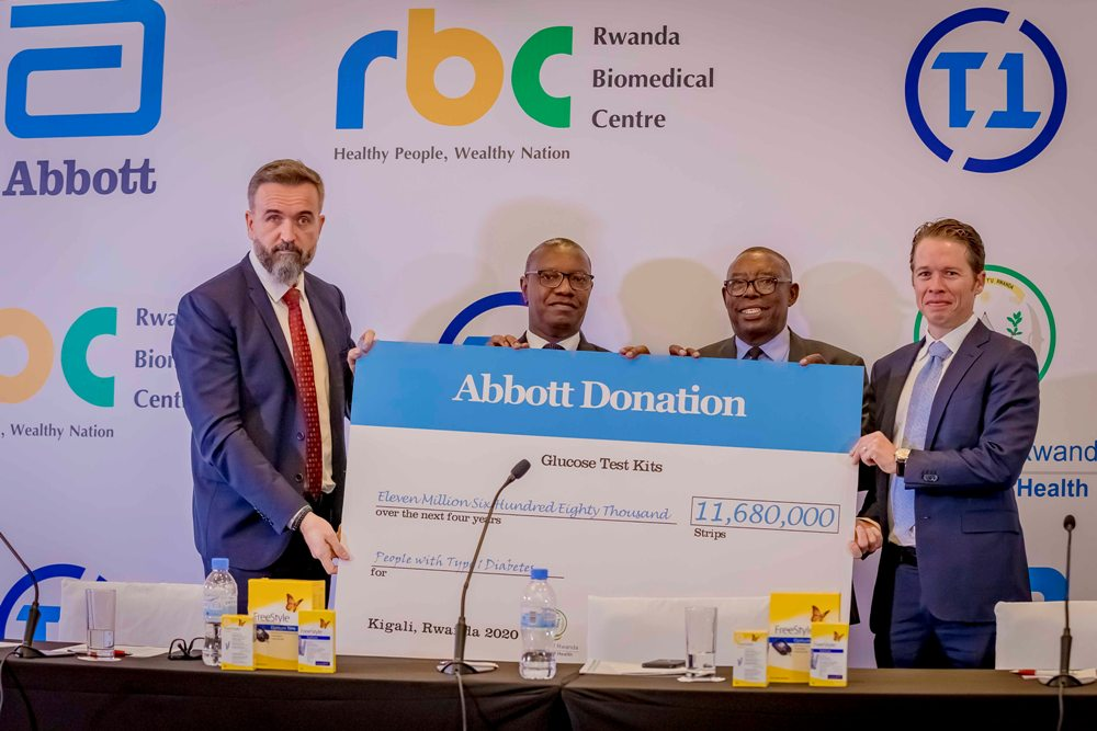 Rwandan government officials (centre) receive a donation of FreeStyle Optium Neo glucose meters and 11,680,000 FreeStyle Optium test strips from Abbott through Team Type 1 Foundation. Courtesy Photo