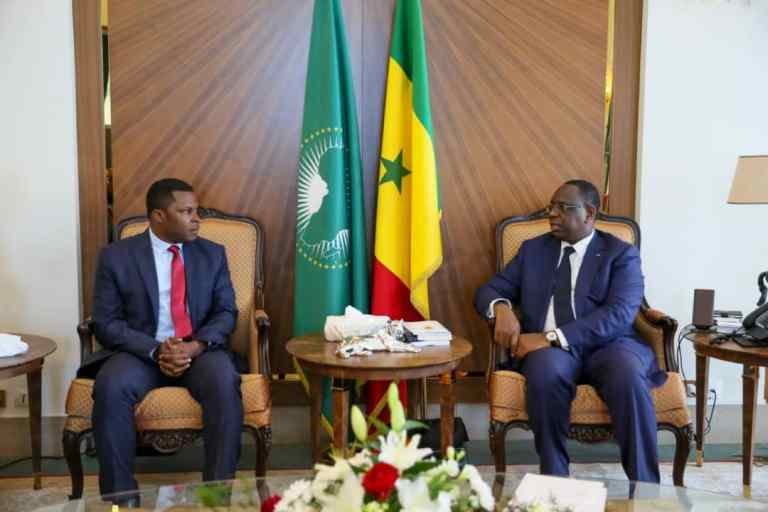NJ Ayuk of the African Energy Chamber with Senegalese President Macky Sall