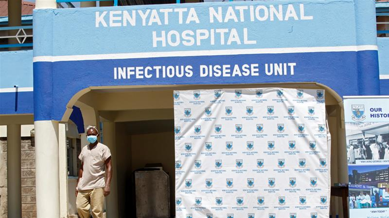 A worker walks outside the coronavirus isolation facility at the Mbagathi Hospital in Nairobi .Photo credit [Njeri Mwangi/Reuters]